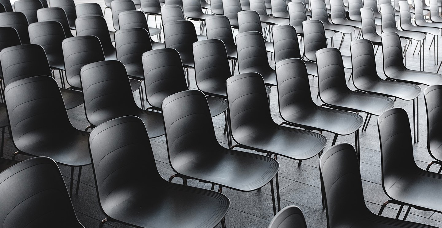 Cover image of chairs in a lecture hall